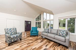 living room with custom flooring and led lighting